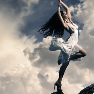 brunette-girl-dancing-on-mountain-top-clouds-sp-3840x2160.jpg